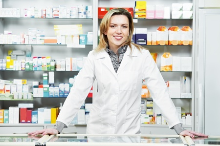 Pharmacy chemist woman in drugstore photo