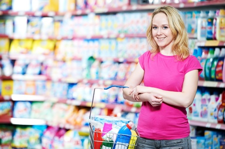 woman at household chemistry shopping photo