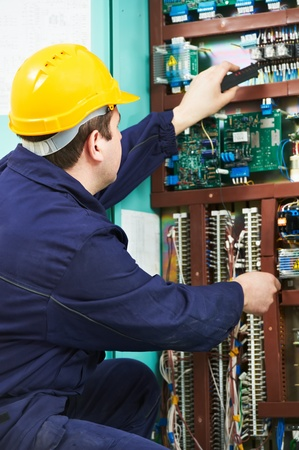 Electrician checking current at power line box Stock Photo - 13111002