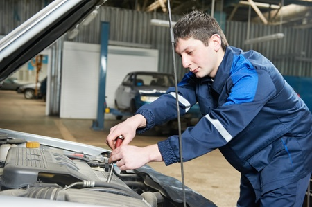 auto mechanic at work with wrench Stock Photo - 13111013