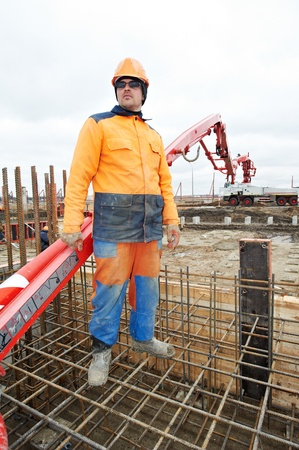 vibration machine: builder worker at concrete pouring work
