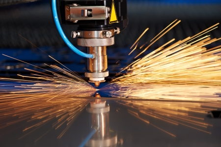 Laser cutting of metal sheet with sparks photo