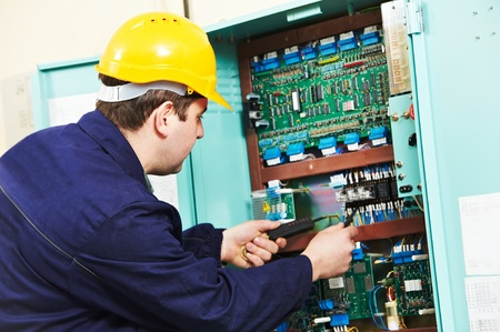 multimeter: Electrician checking current at power line box Stock Photo
