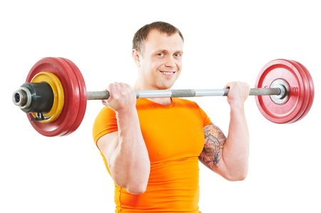 bodybuilder man doing exercises with weight photo