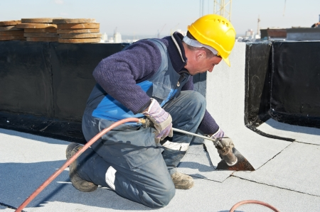 Flat roof covering works with roofing felt Stock Photo - 13220010