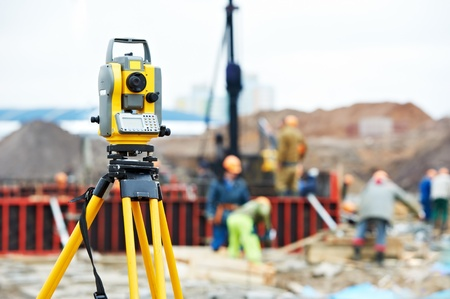 surveyor: surveyor equipment theodolite at construction site