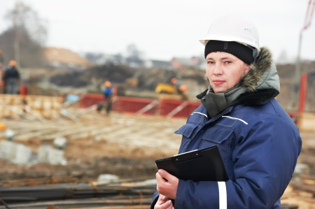 builder resident engineer at construction site photo
