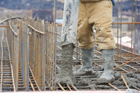 builder worker pouring concrete into form Stock Photo - 13220015