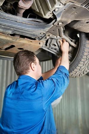 auto mechanic at car suspension repair work Stock Photo - 13220013