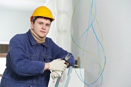 cabling: Electrician at cable wiring work Stock Photo