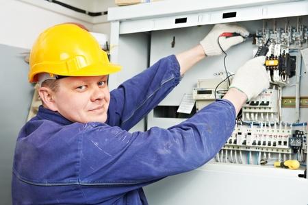 multimeter: Electrician measure voltage with multimeter
