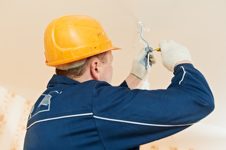 manual test equipment: Electrician at cable wiring work Stock Photo