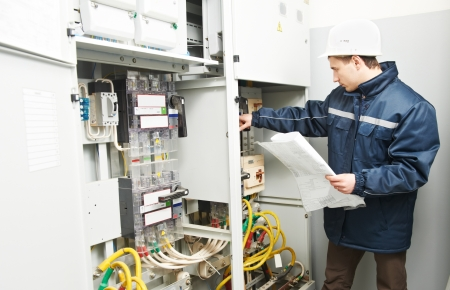 Electrician checking cabling power line Stock Photo - 13293579