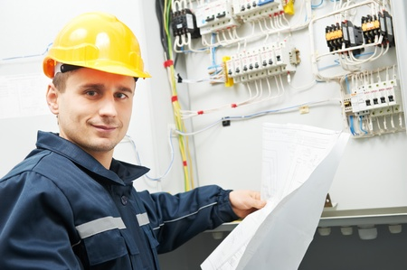 electrical contractor: Electrician checking cabling power line Stock Photo