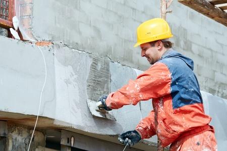 Facade Plasterer at work