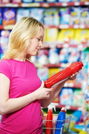 woman at household chemistry shopping supermarket photo