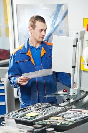 worker at machine tool in workshop Stock Photo - 13425768