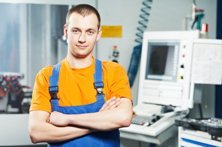 man machine: worker at tool workshop Stock Photo