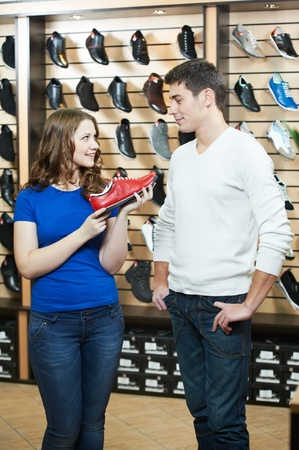 man and assistant at shoe shopping photo