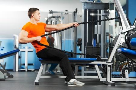 bodybuilder man doing exercises in fitness club photo