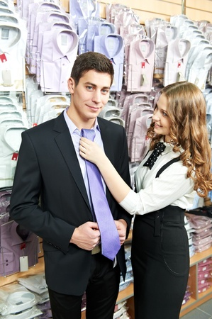 man and assistant at apparel clothes shopping Stock Photo - 13425790