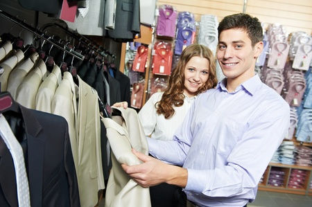 Young peoples shopping at clothes store photo