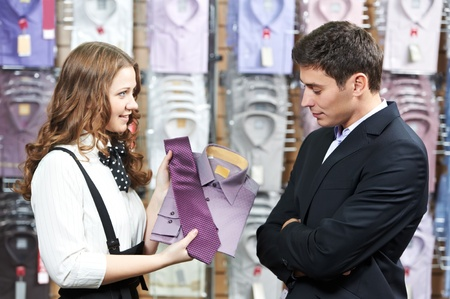 seller: man and assistant at apparel clothes shopping