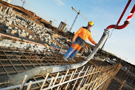 builder worker at concrete pouring work Stock Photo - 13425793