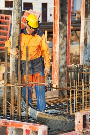 builder worker at concrete pouring work Stock Photo - 13425781