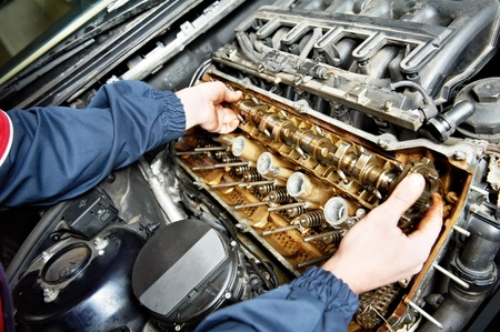 machanic repairman at automobile car engine repair photo