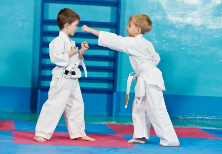 aikido: two boys make karate exercises Stock Photo