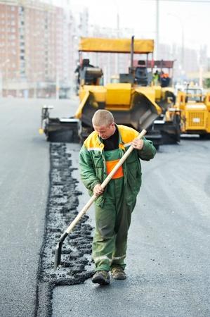 worker at asphalting works photo