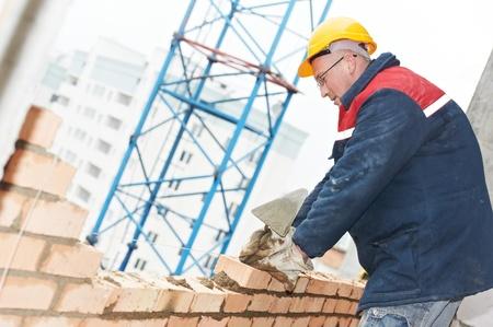 construction mason worker bricklayer photo