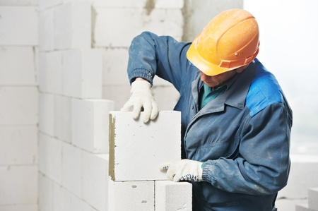plastering: construction mason worker bricklayer Stock Photo