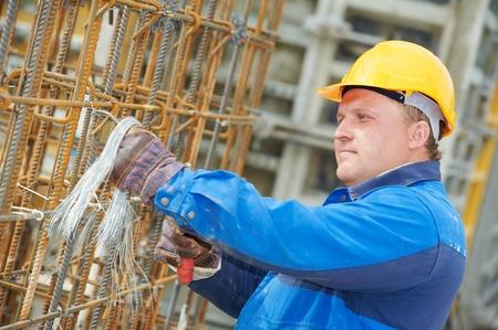 formwork: construction worker making reinforcement