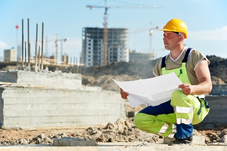 foremaster: Engineer builders at construction site with draft Stock Photo