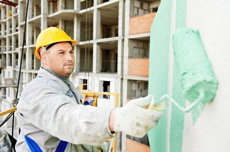 painter: builder facade painter at work Stock Photo