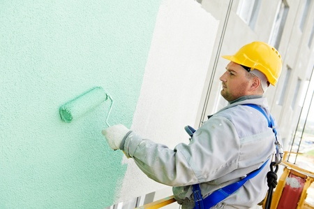 builder facade painter at work Stock Photo