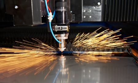Laser cutting of metal sheet with sparks Stock Photo - 13425815