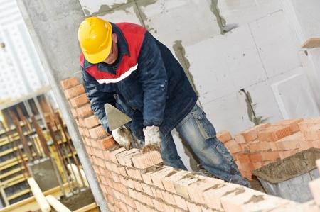 brick mason: construction mason worker bricklayer Stock Photo