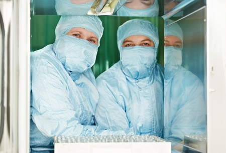 Two pharmaceutical factory workers photo