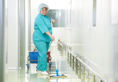 cleaning services: Woman cleaning hospital hall Stock Photo