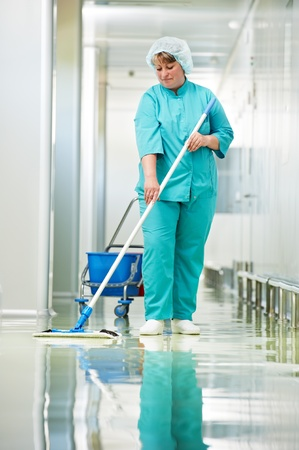 floor standing: Woman cleaning hospital hall Stock Photo