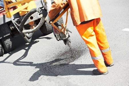 Asphalt patching roadworks Stock Photo - 13536006