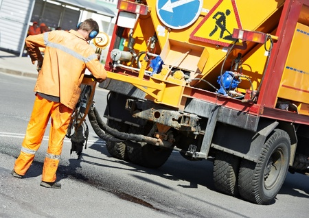 patching: Asphalt patching roadworks Stock Photo