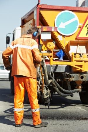 roadworks: Asphalt patching roadworks Stock Photo