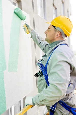 steeplejack: builder facade painter at work Stock Photo