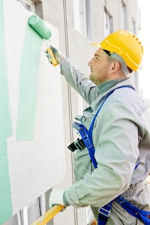 plastering: builder facade painter at work Stock Photo