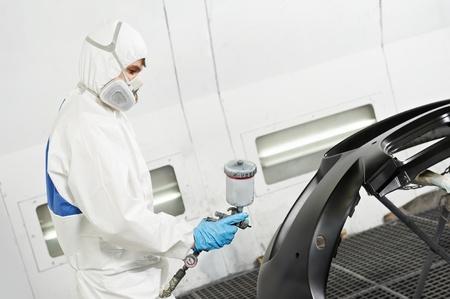 auto repair shop: mechanic repairing and polishing car headlight Stock Photo