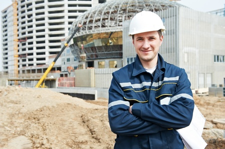 taskmaster: foreman at construction site with working drawings
